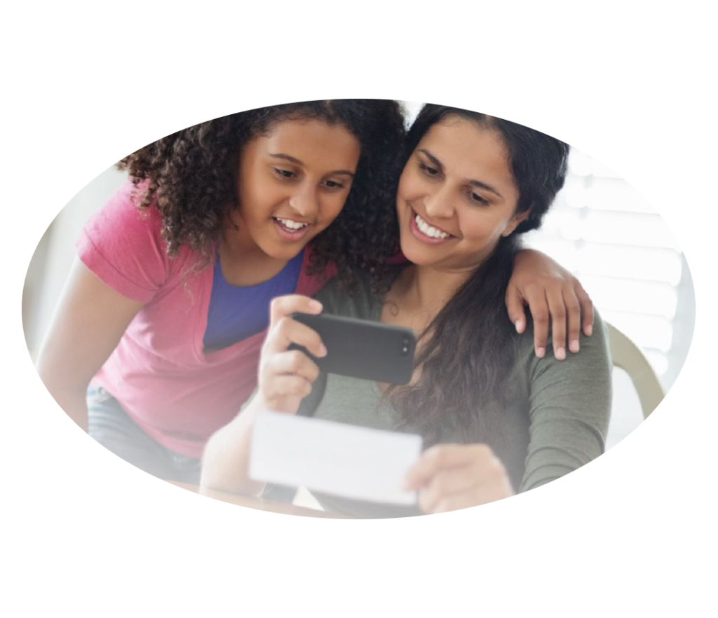 Mom and daughter scanning check with smartphone