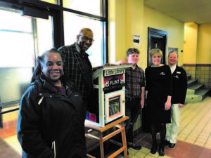 Dort Federal Credit Union Installs Little Free Library At Berston
